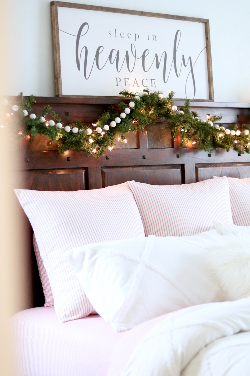 Cozy Farmhouse Christmas Bedroom - Look Here Jane Pillow Covers - Christmas Bedding - Candy Cane Pillows - Red Stripe Ticking Farmhouse Pillows - Sleep In Heavenly Peace Sign - Christmas Garland on Bed #FarmhouseChristmas #Christmasbedroom #christmasdecor #bedroom